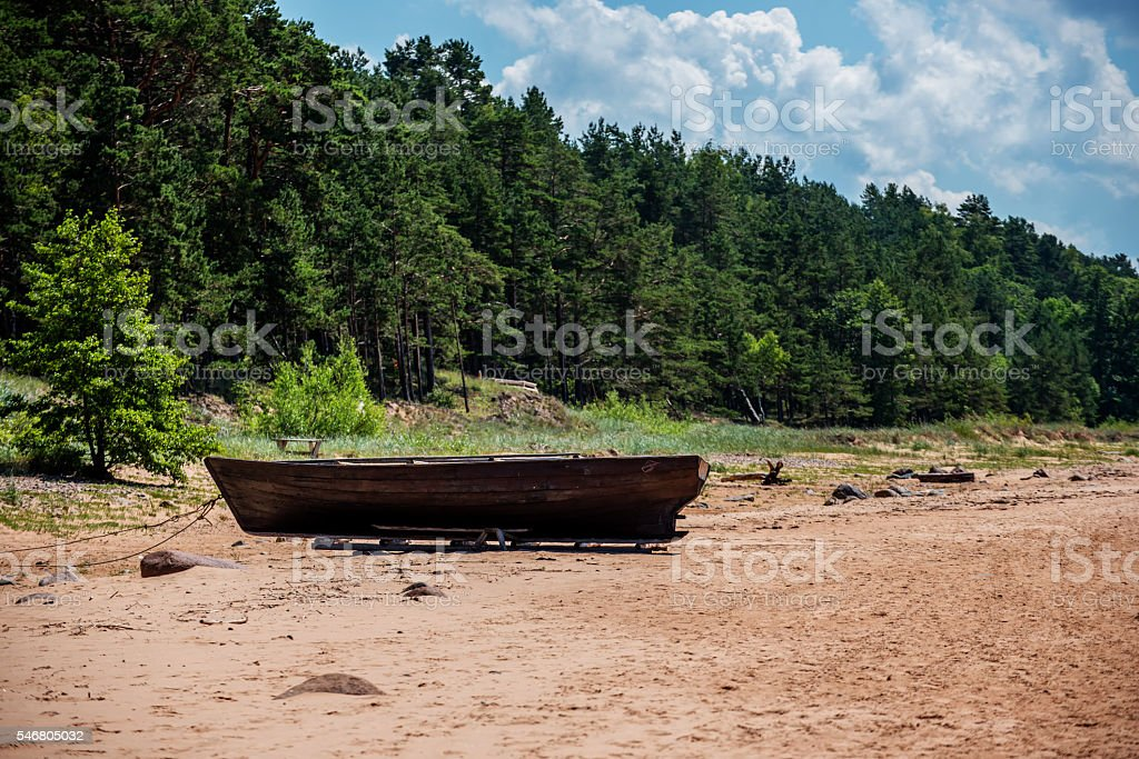Wooden Fishing Boat on Beach stock photo