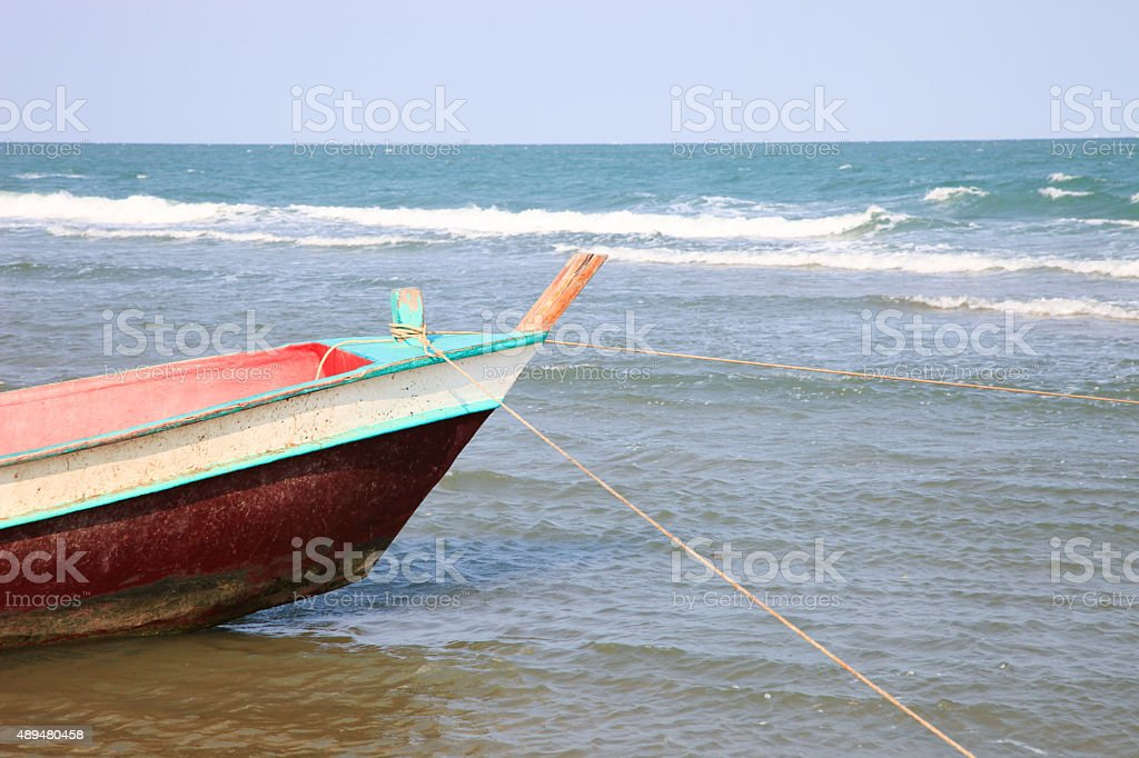 Wooden fishing boat on the beach stock photo