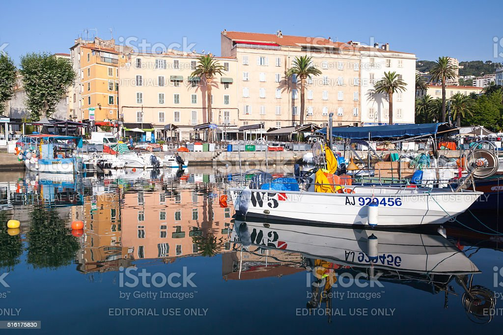 Wooden fishing boats and pleasure motorboats stock photo