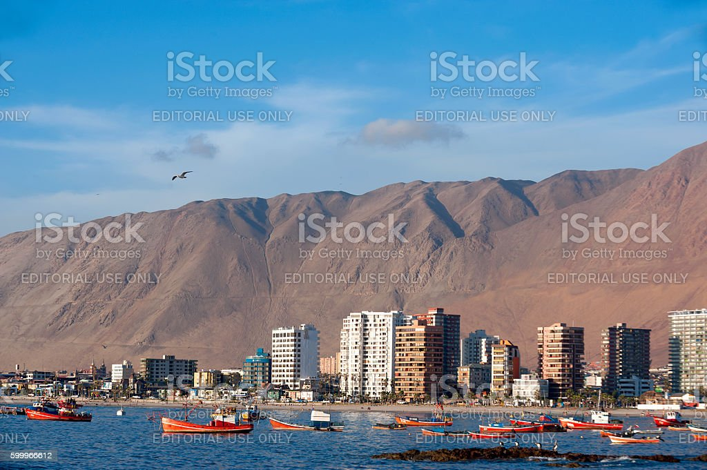 Wooden fishing boats in the harbour are resting after the storm stock photo