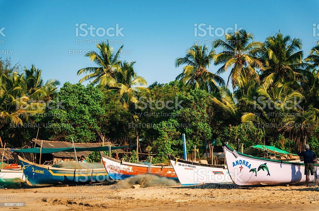 Wooden fishing boats on Morjim beach, North Goa, India стоковое фото