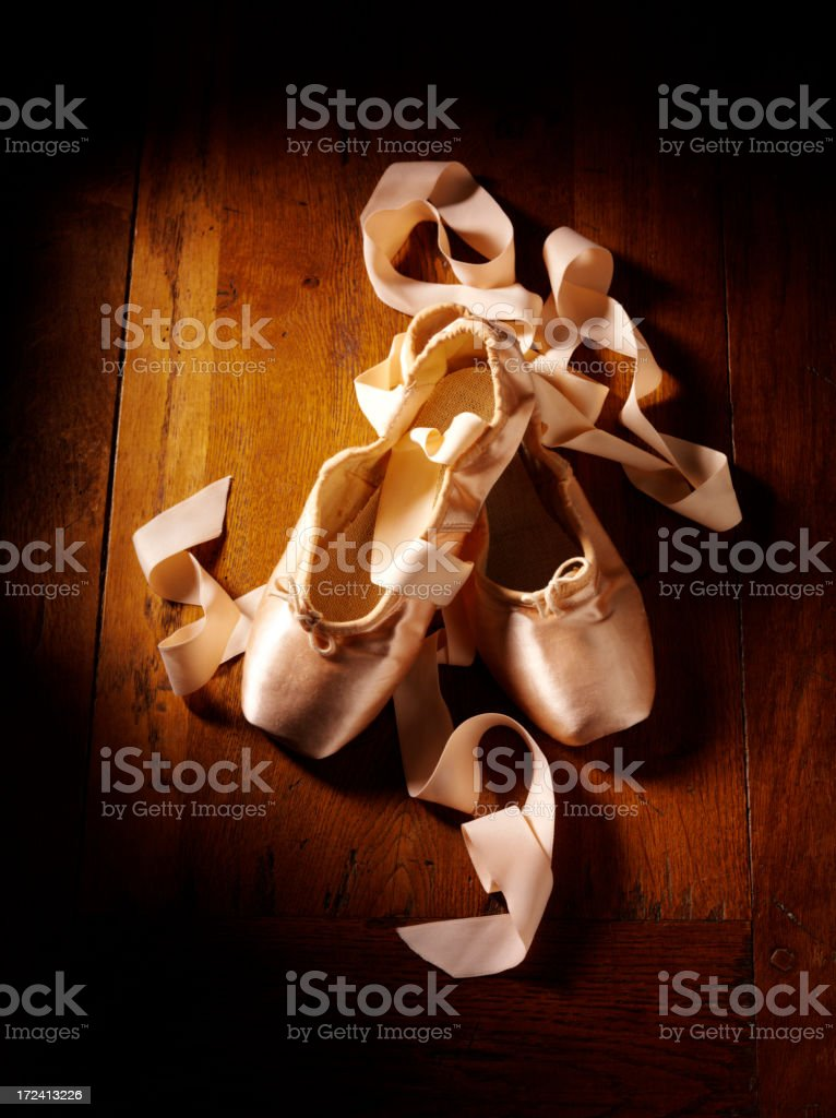 Wooden Flooor with a Pair of Ballet Shoes royalty-free stock photo