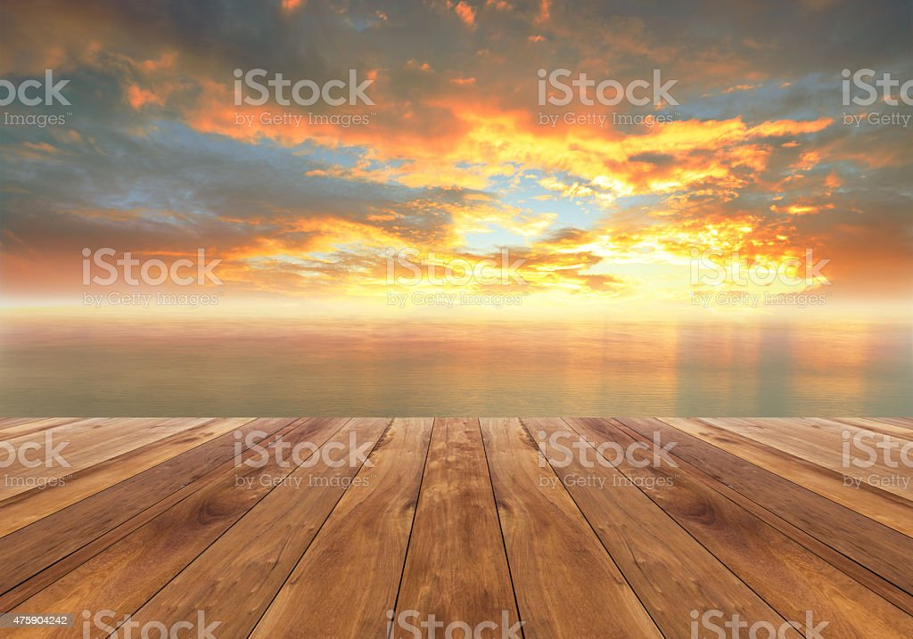 wooden floor and beautiful sunrise stock photo