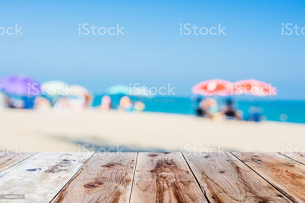 wooden floor and blurred beach atmosphere stock photo