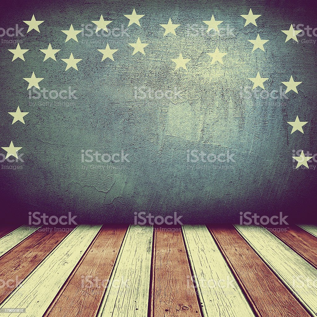 Wooden floor and concrete wall painted in the USA colors stock photo