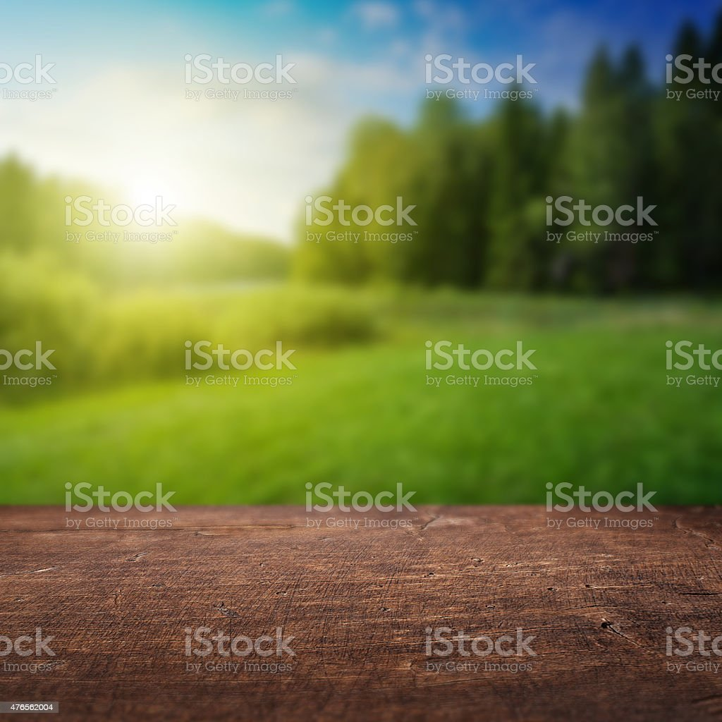 Wooden floor and defocused summer landscape on background stock photo