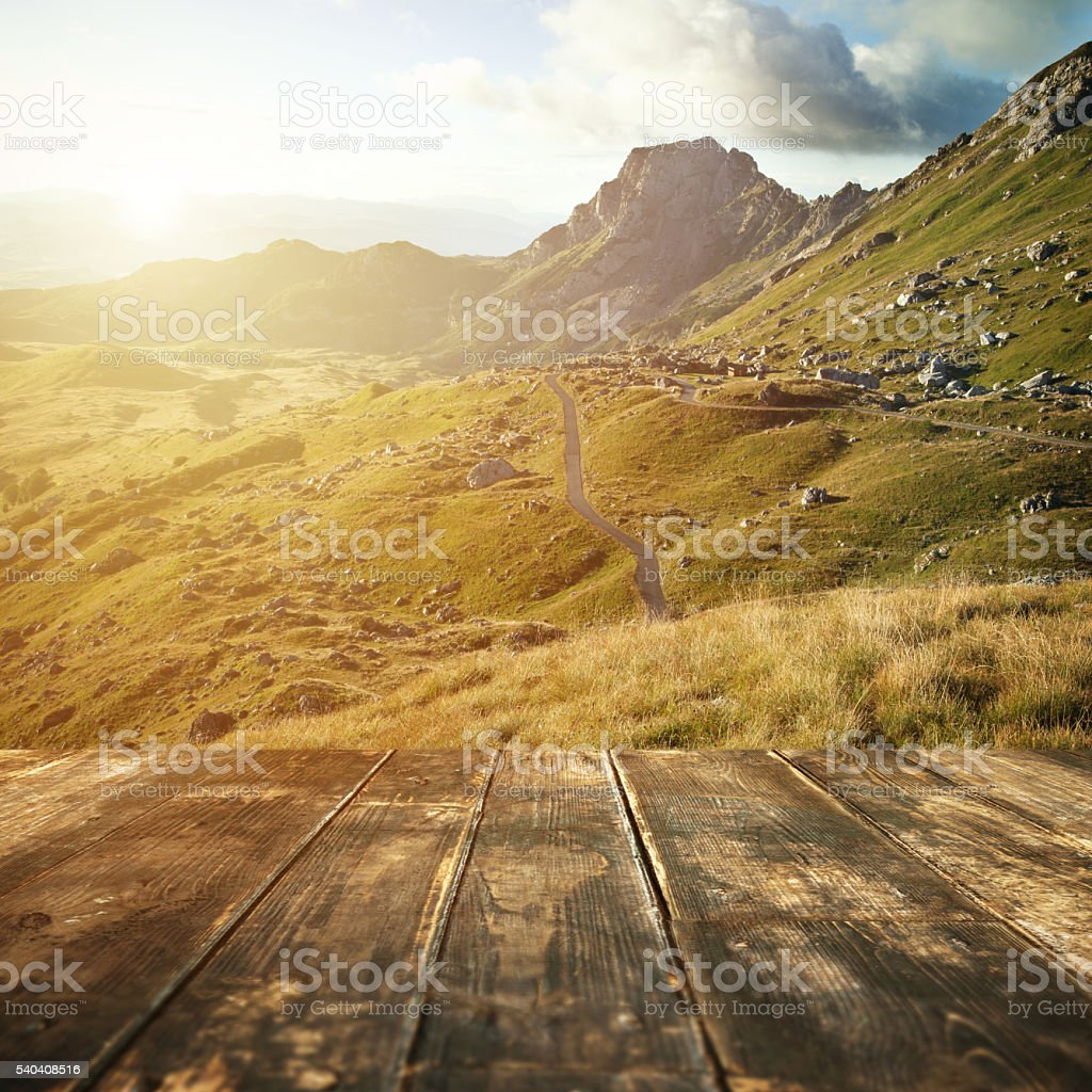 Wooden floor and mountain valley landscape on background stock photo