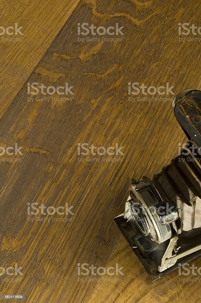 Wooden Floor and Old Camera royalty-free stock photo