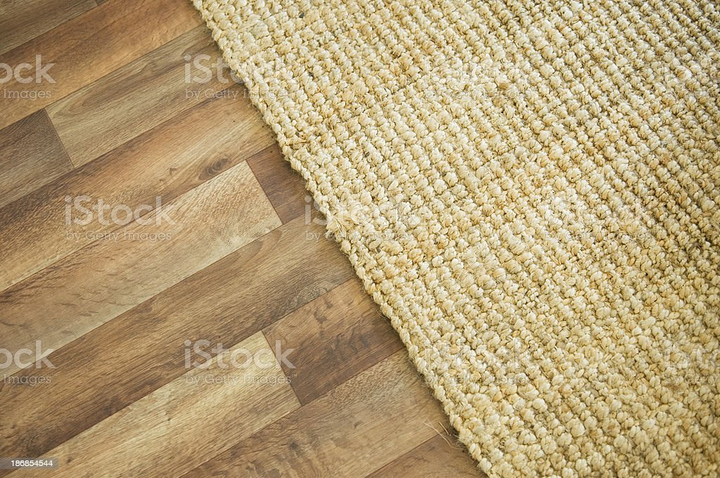 Wooden floor and rug stock photo