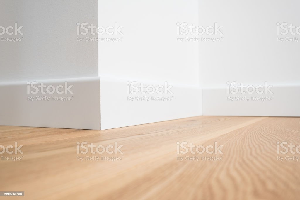 wooden floor parquet and white walls stock photo