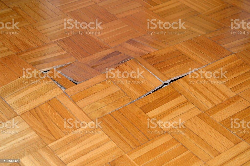 Wooden Floor Starts to Lift Up stock photo