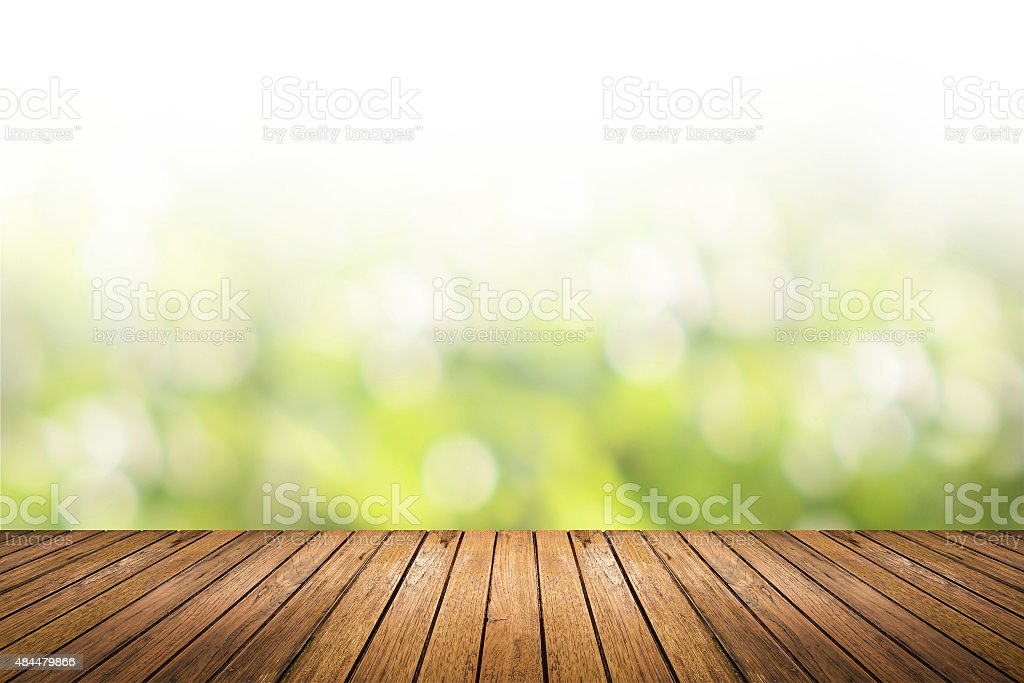 wooden floor with green nature blurred background stock photo