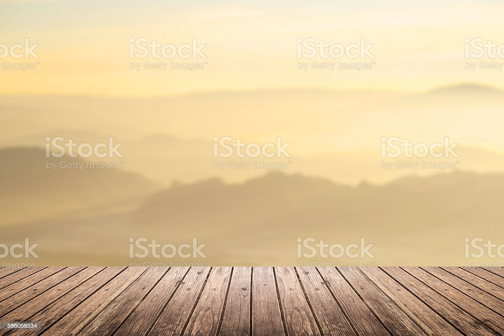 wooden floor with mountain blurred background stock photo