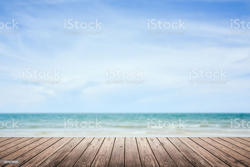 wooden floor with sea and sky blurred background stock photo