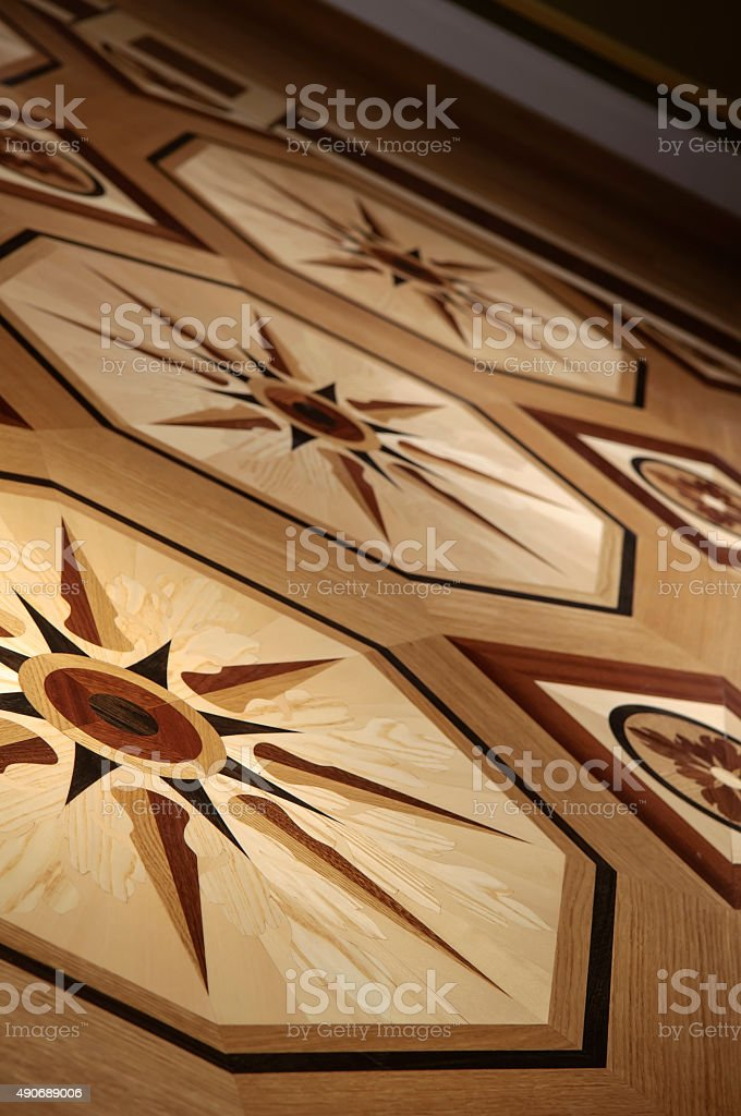 Wooden flooring from expensive wood in the form of the ornament stock photo