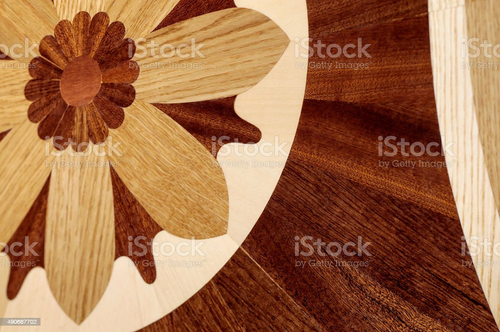 Wooden flooring in the form of a flower stock photo