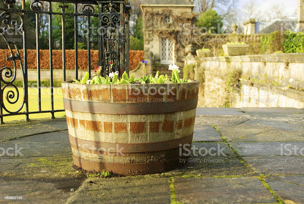 Wooden flower pot in a garden stock photo