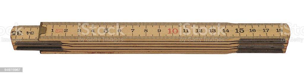 Wooden folding rule stock photo