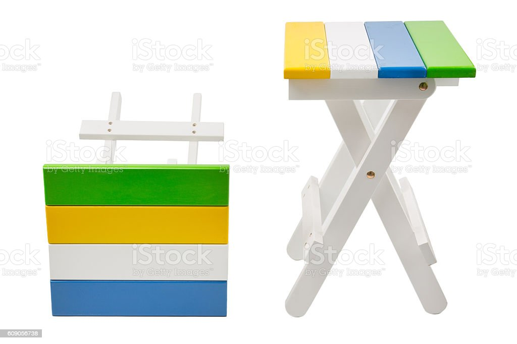 Wooden folding stool stock photo
