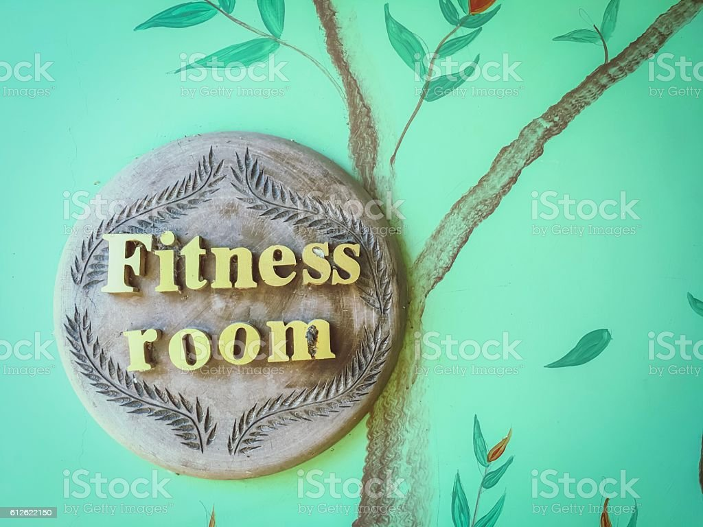 wooden font 'Fitness room' on the green concrete background royalty-free stock photo