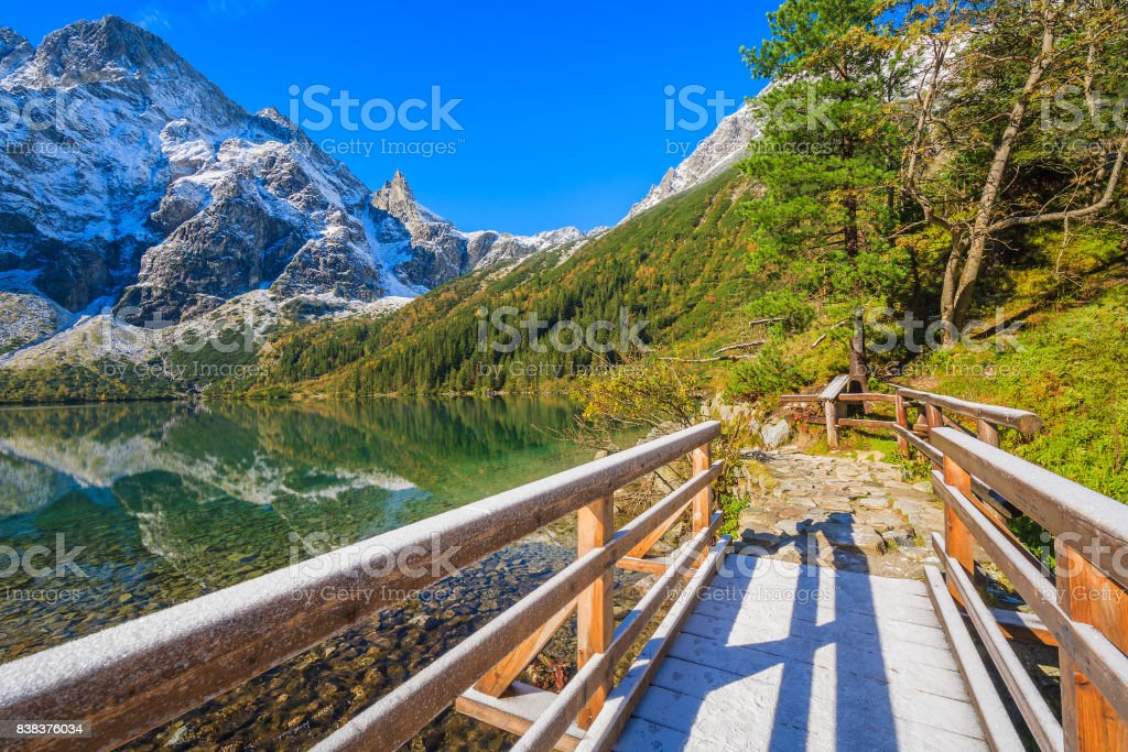 Wooden footbridge near Morskie Oko lake in autumn season, Tatra Mountains, Poland stock photo