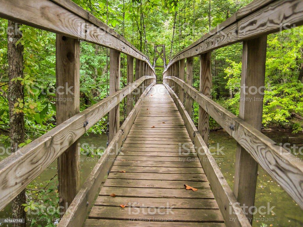 Wooden Footbridge Over River stock photo
