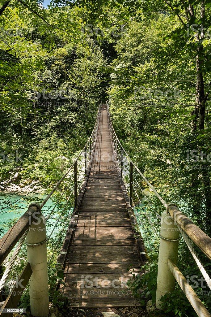 Wooden footbridge over river Soca stock photo