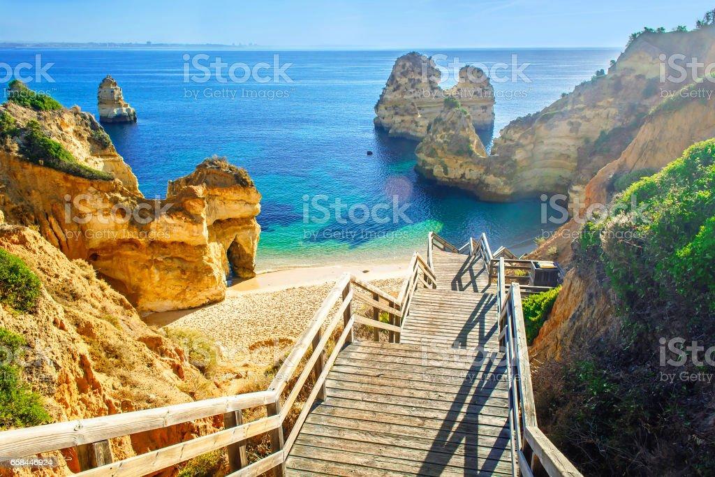 Wooden footbridge to beautiful beach Praia do Camilo near Lagos stock photo