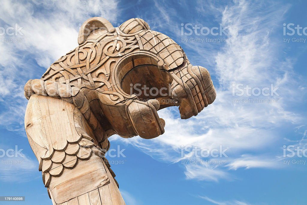 Wooden forepart of the ancient Viking ship isolated on white royalty-free stock photo