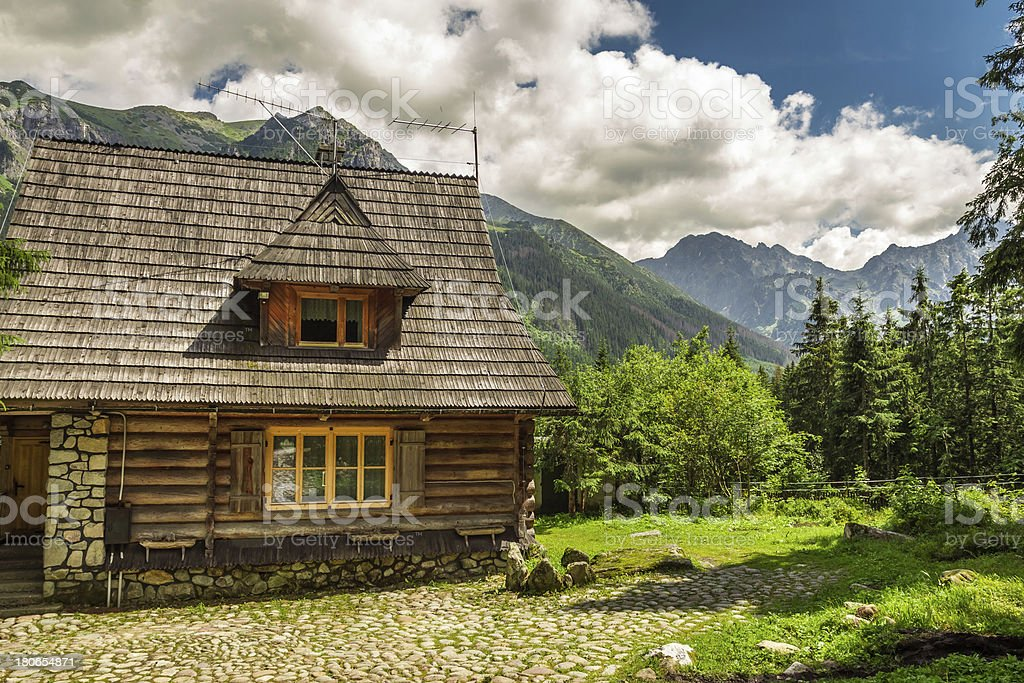 Wooden forester cottage in the mountains royalty-free stock photo