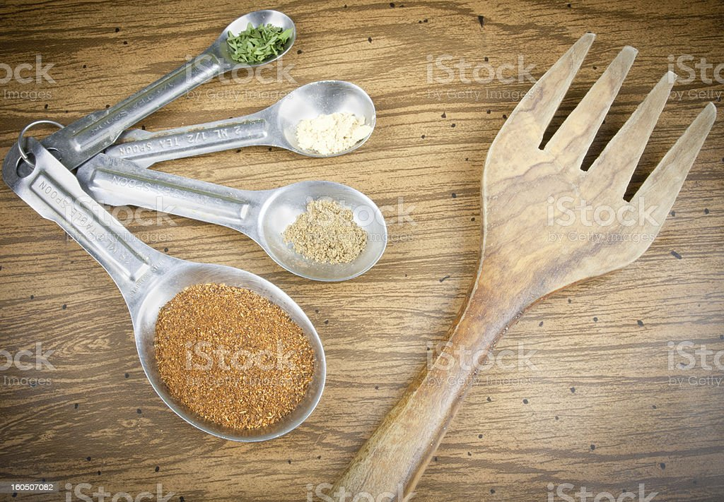 Wooden Fork And Spices In Spoons royalty-free stock photo