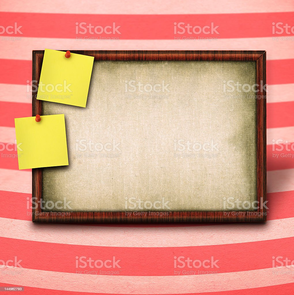 wooden frame and to yellow notes stock photo