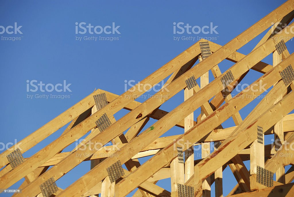 Wooden frame to build a house with arches and blue sky royalty-free stock photo