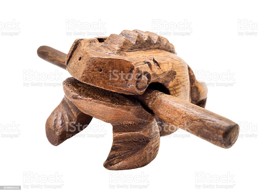 Wooden Frog toy that making croaking sound stock photo