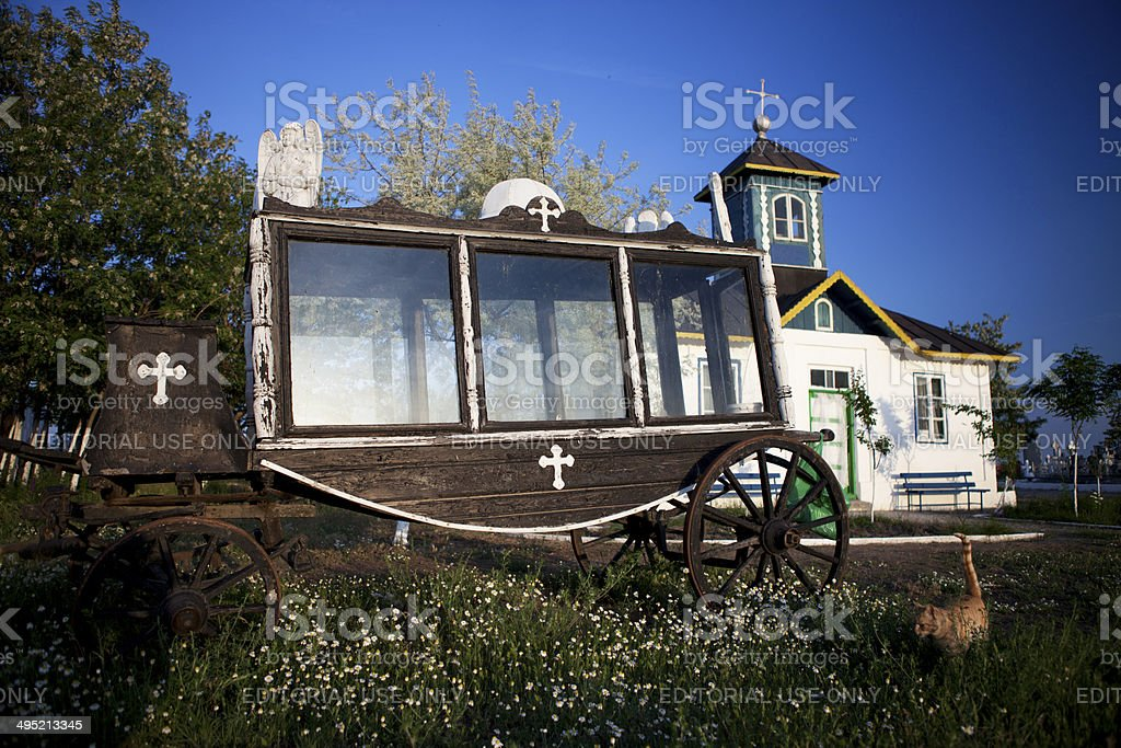Wooden funeral car in front of church, Danube Delta stock photo