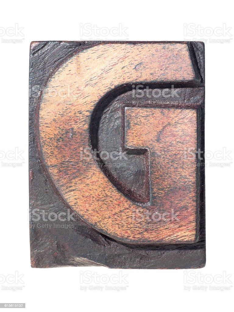 wooden G typeface stock photo
