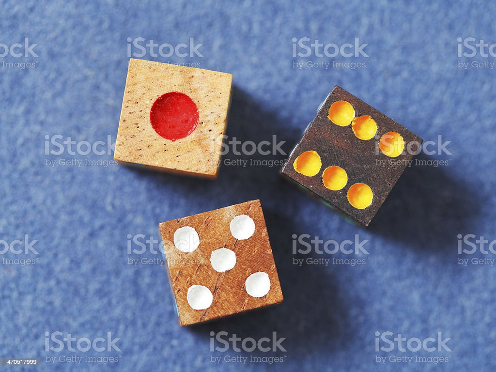 wooden gambling dices on blue cloth closeup stock photo