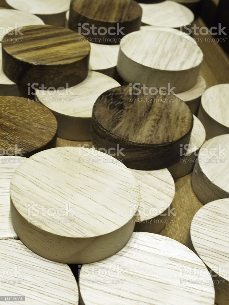 Wooden game pieces like hockey pucks (shallow depth of field) stock photo