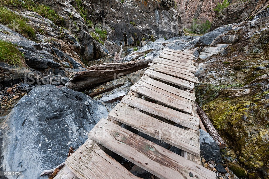 Wooden gangway in a gorge stock photo