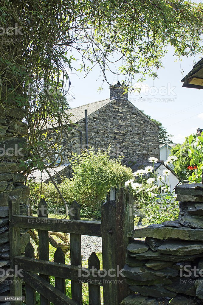 Wooden gate and cottage stock photo