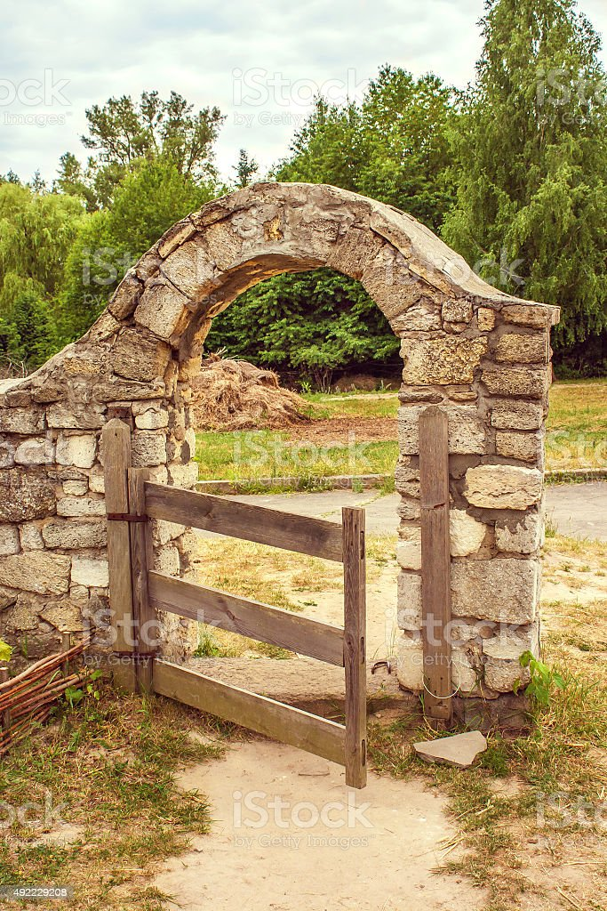 wooden gate in the stone fence stock photo