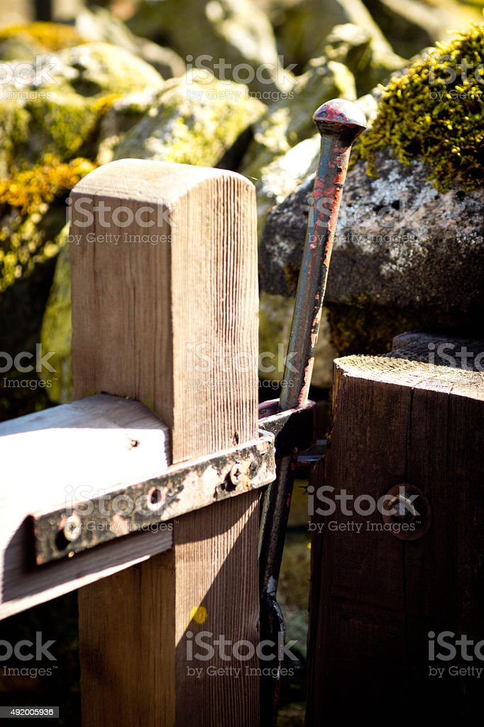 Wooden gate lock stock photo