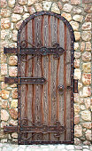 Wooden gate with forged