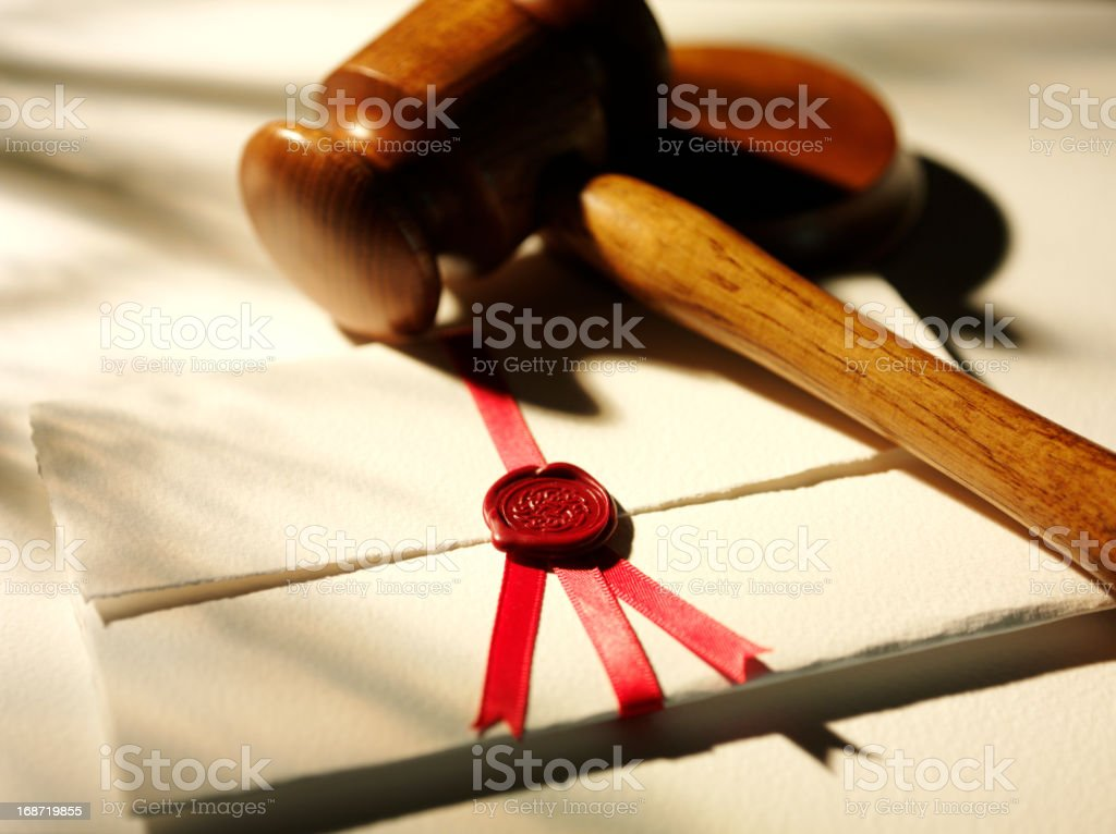 Wooden Gavel and a Legal Document royalty-free stock photo