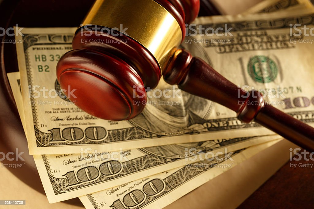 Wooden gavel and dollar stock photo