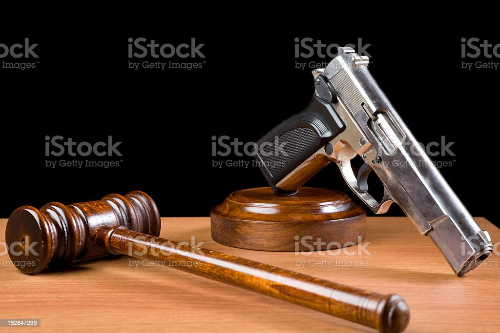 Wooden Gavel And Handgun On Table For Crime Punishment Concept royalty-free stock photo