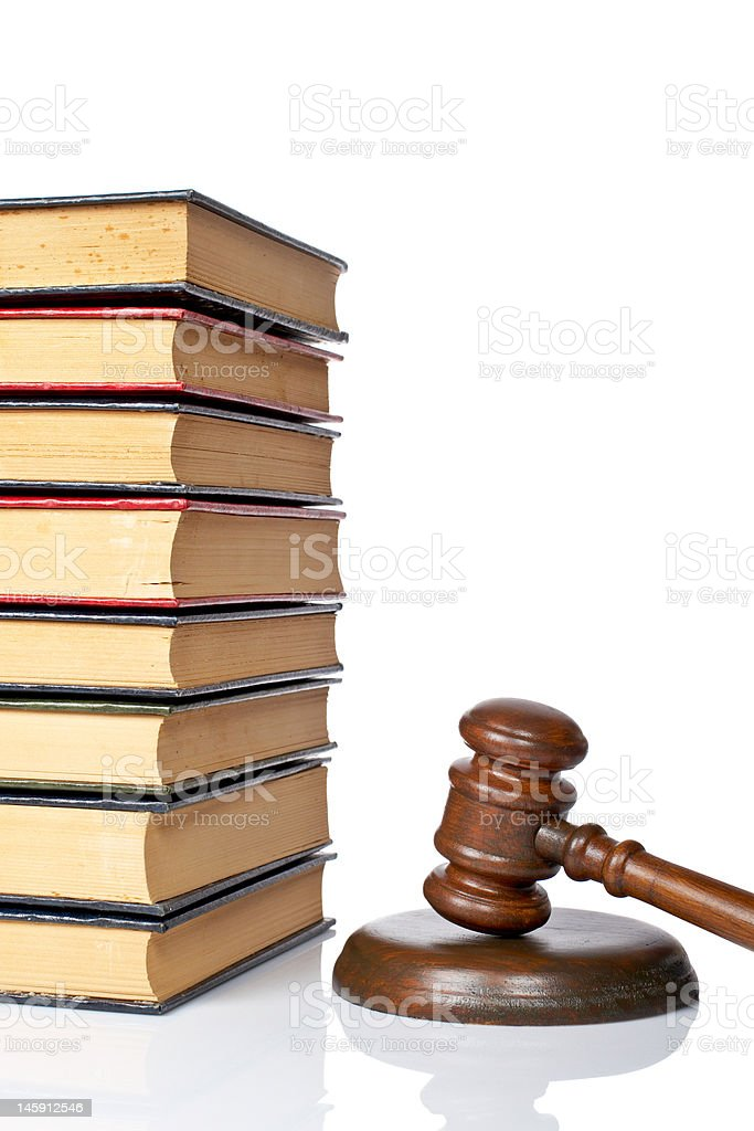 Wooden gavel and old law books royalty-free stock photo