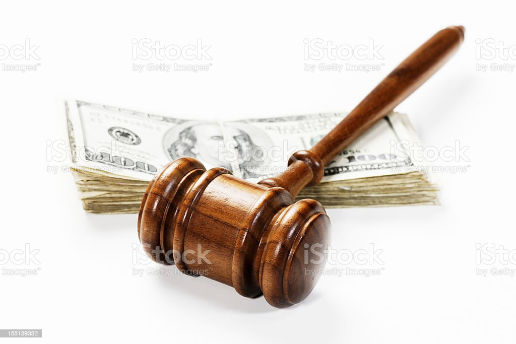Wooden gavel and US dollars: bribery, a fine or payment royalty-free stock photo