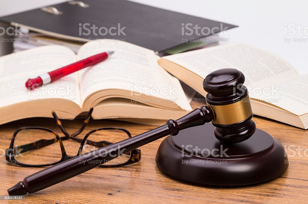 Wooden gavel on a table stock photo