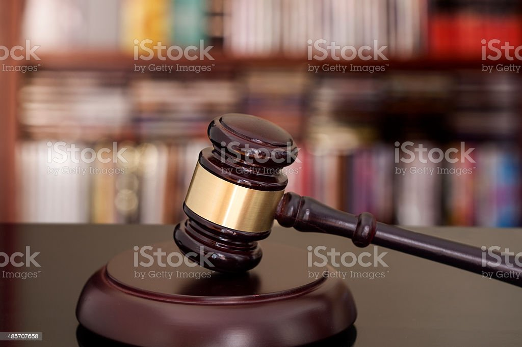 Wooden gavel on library background stock photo
